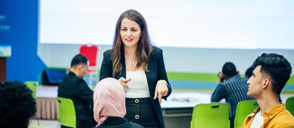 Woman speaking at Young Innovators Leaders Forum 2019 - ITU